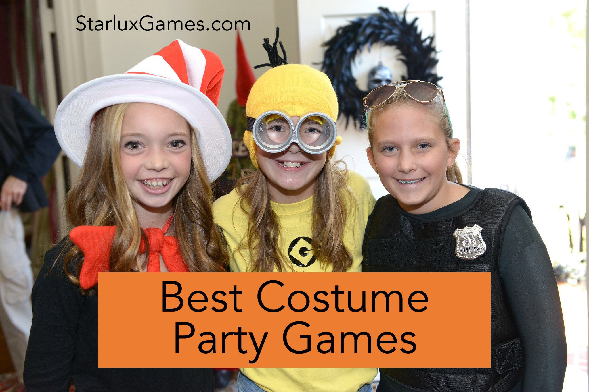Three girls pose together smiling at the camera in Halloween costumes.