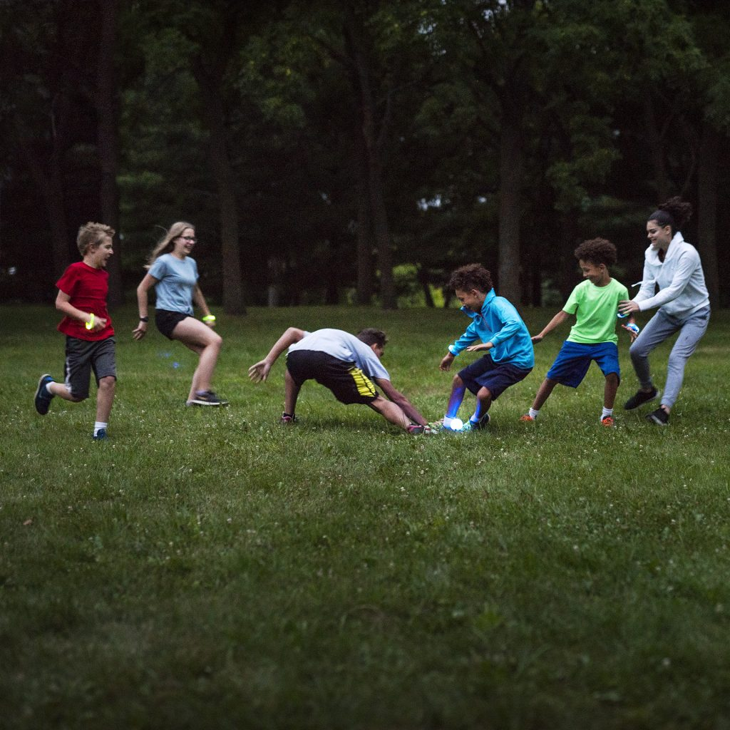 One player attempts to grab the glow in the dark flag in a game of Capture the Flag.