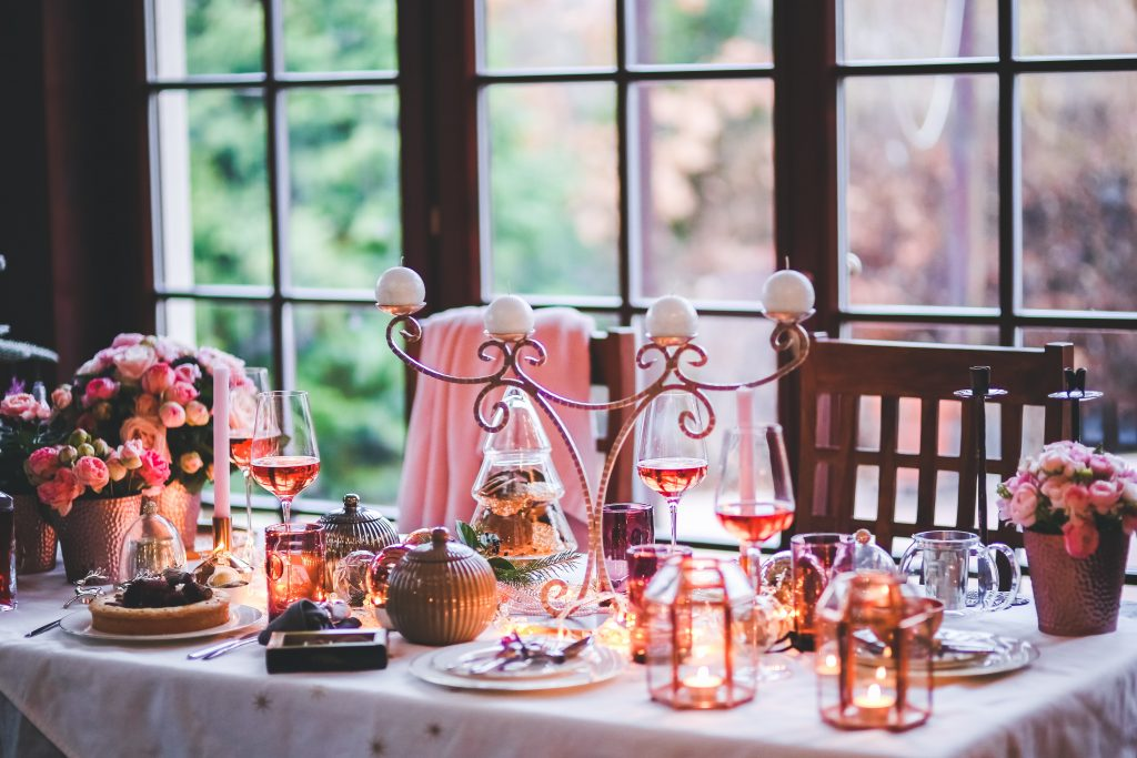 A table is set with holiday decor and food.