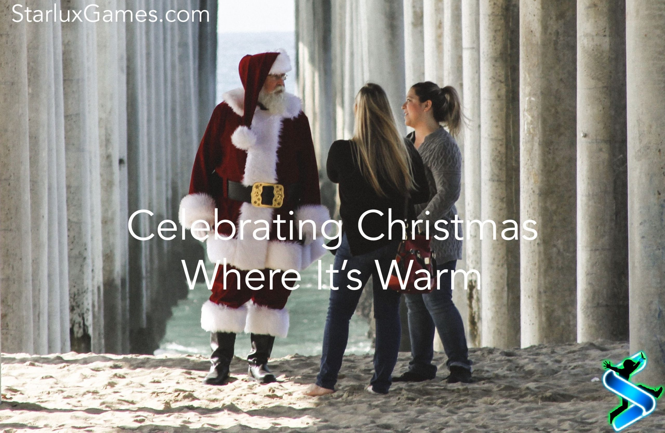 Santa Claus stands on a beach talking to two people